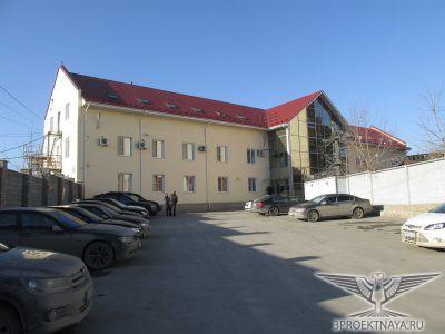 Фото 1. Фасад здания в осях 1-4_А
